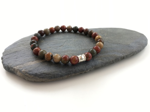 Beautiful Picasso Jasper bracelet with Sterling silver barrel bead. The Picasso Jasper is in hues of dark green and red with browns and beige mixed in. Each bead is unique in its patterning.