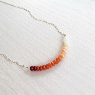 In ombré colours from red to orange, peach and white.