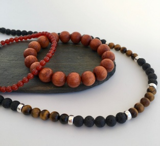 Red Carnelian, orange Bayong wood bracelets and Lava and Tigers eye bracelet.