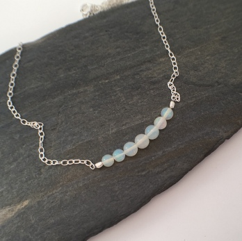 Beautiful genuine AA Ethiopian Opal on Sterling silver chain. Perfect for an October birthday gift.