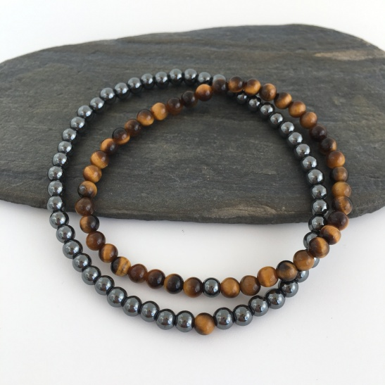 The tigers eye bracelet has a single Hematite bead and the Hematite bracelet has a single Tigers eye bead.
